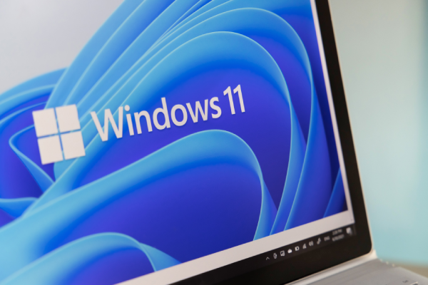 Open laptop with a Windows 11 image on screen
